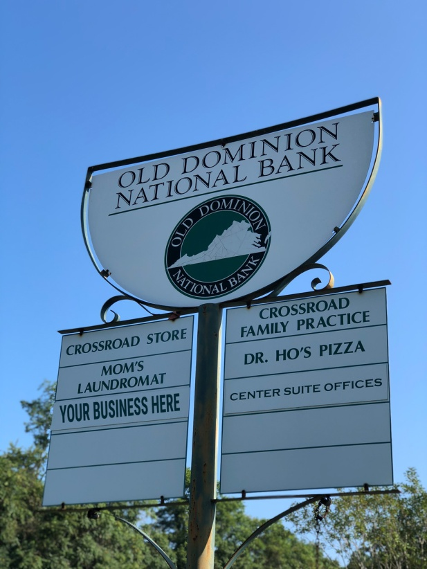 crossroad corner shops local businesses signage